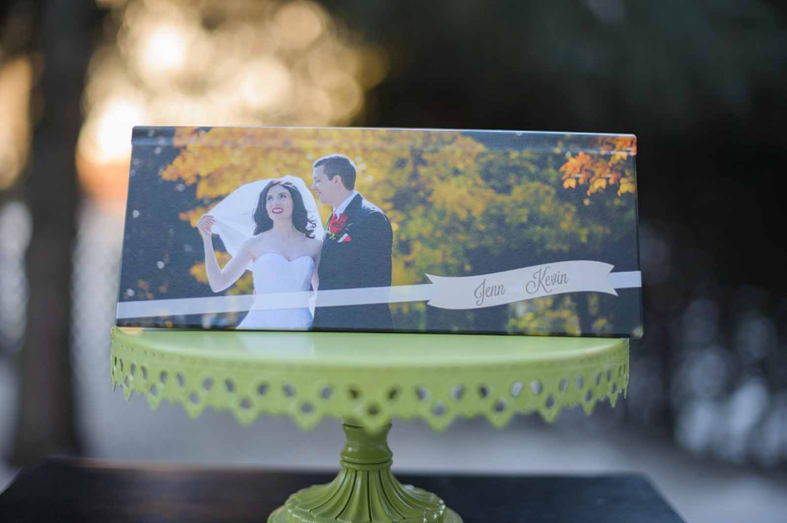 PanoVista wedding album displayed on a green cake stand
